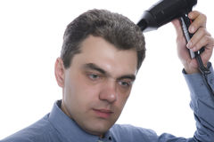 Men with hairdryer close up Royalty Free Stock Photo