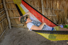 Man in hammock. Tourist man relaxes on a hammock. A Conception Baja, California Sur, Mexico Royalty Free Stock Image