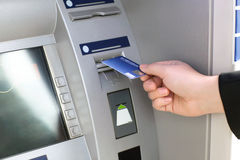 Men hand businessman puts credit card into ATM Royalty Free Stock Photo