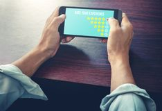 Men hand choose icon five star symbol on smart phone to increase rating of company stock images