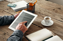 Men hand clicks on the screen blank tablet Stock Photo