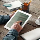 Men hand clicks on the screen blank tablet Royalty Free Stock Images