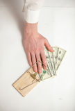 Men hand got caught in mouse trap while he was stealing money Royalty Free Stock Images