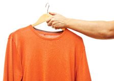 Men hand holding hanger with sweater Royalty Free Stock Photos