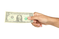 A Men hand holding one dollar bill on white background. Royalty Free Stock Images