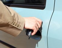Men hand open car door royalty free stock image