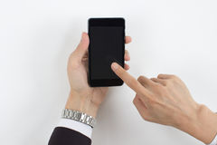 Men hand touch mobile phone Royalty Free Stock Photography
