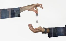 Men hands handing over house keys, apartments, cars on an isolated stock photos