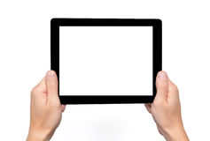 Men hands hold a tablet touch computer gadget with isolated screen stock image