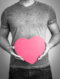 Men hands holding heart shape Stock Image