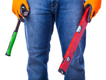 Men hands holding tools. Part of the men hands holding tools royalty free stock photo