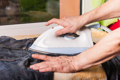 Men hands ironing clothes Stock Photography
