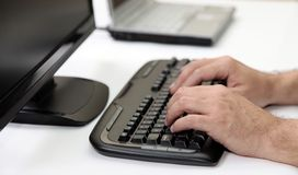Men Hands on PC Keyboard Stock Image