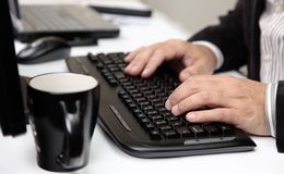 Men Hands on PC Keyboard Stock Photos