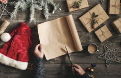 Men hands preparing Christmas presents on wooden table. Top view Royalty Free Stock Photos