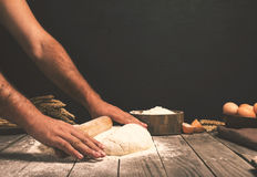 Men hands roll out dough close up Royalty Free Stock Image