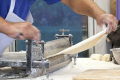 Men hands roll out dough close up. Royalty Free Stock Photography