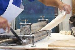 Men hands roll out dough close up. Stock Photos