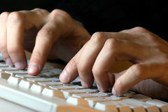 Men hands typing Stock Images
