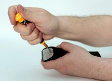 Men hands untwist the bolts with a screwdriver blade clipper the hair stock photo