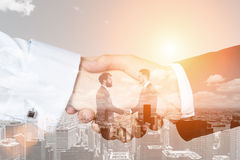 Men and handshake close up in a city, toned Stock Photography