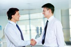 Men handshaking. Portrait of two businessmen handshaking and greeting each other Stock Photos