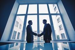 Men handshaking Stock Photography