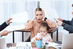 Men have a complaint about a woman who came with her daughter to work. royalty free stock photography