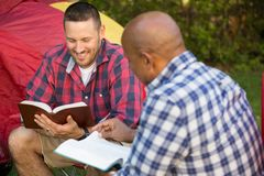 Multi-Ethnic group of friends talking and having a bible study. Stock Images