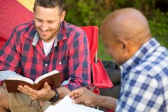 Men having a bible study. Men having a bible study on a camping trip royalty free stock photography