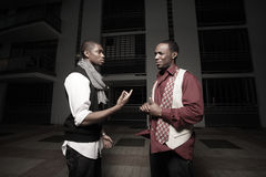 Men having a conversation. Two African American men having a conversation at night Stock Photo