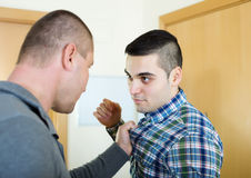 Men having fight at home Stock Photography