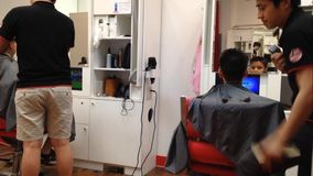 Men having an haircut in a hairdressing salon Royalty Free Stock Photos