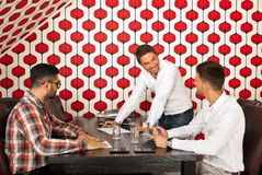 Men having happy discussion at meeting Royalty Free Stock Photography