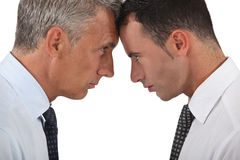 Men head butting. Two businessman almost coming to blows Royalty Free Stock Images