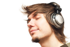 Men in headphones listening music Stock Images