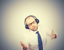 Men in headphones listens to music and sings. Stock Photography