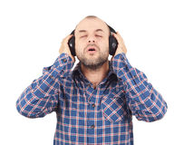 Men in headphones listens to music and sings. Stock Photos