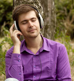 Men with headphones at the park Royalty Free Stock Photos