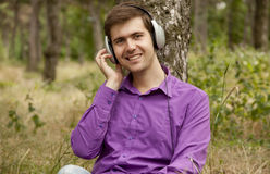 Men with headphones at the park Stock Photo