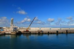 Men with heavy machinery working at the port. Of Tangier, Morocco Royalty Free Stock Images