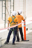 Men with helmets standing Stock Image