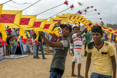 Men help to hold up a Japanese kite prior to take off on Negombo beach in Sri Lanka. This kite was one of hundreds being flown during the annual kite festival Stock Image