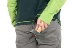 Men hides  hammer. On  white background Stock Image