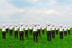 Men hiding their faces behind sad sing Royalty Free Stock Image