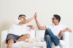 Men high five Stock Images
