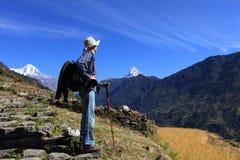 Men Hiker,Himalaya Mountains,Nepal. Men hiker walking in Himalaya Mountains in Nepal. Fish tail as background stock images