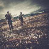 Men hikers in Scandinavia. Two hikers walking in a valley royalty free stock image