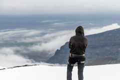 Men Hiking glacier Hvannadalshnukur summit in Iceland mountain landscape Vatnajokull park Royalty Free Stock Photo