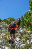 Men hiking. On a marked trail on the mountain. Sport and active life Royalty Free Stock Photos